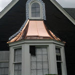 New shiny copper roofing being freshly installed
