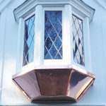 Highly slanted copper roofing for a bay window