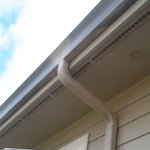 Gutter and downspout that has been repaired guaranteed to prevent leaks