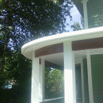 Curving seamless radius gutter wrapping around a round porch